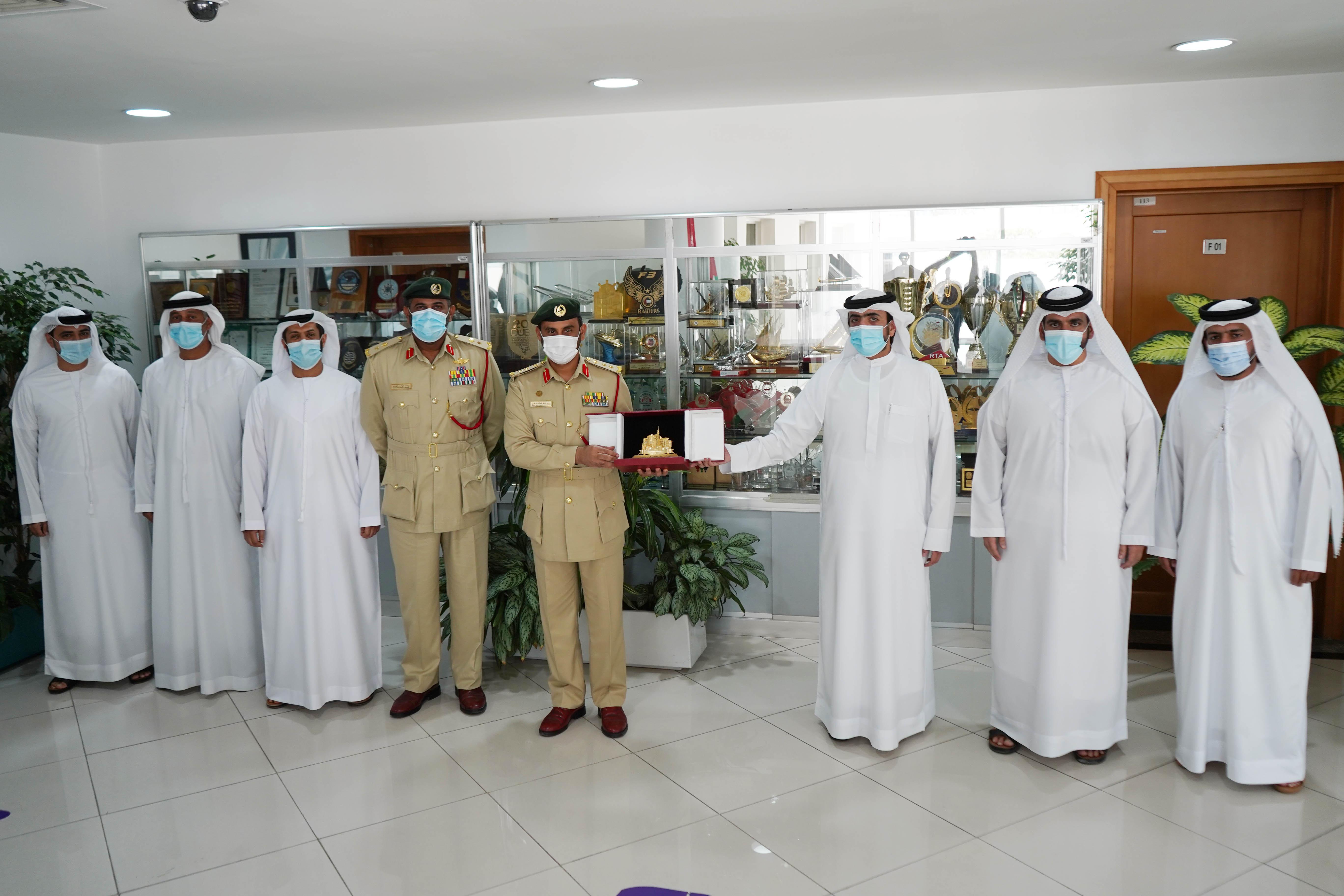 DIMC recieves Dubai Police Commemorative Shield